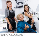 Купить «Hairdressers finished haircut for senior woman», фото № 30425397, снято 26 июня 2018 г. (c) Яков Филимонов / Фотобанк Лори