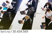 Купить «business people working and communicating together», фото № 30434569, снято 10 марта 2018 г. (c) Яков Филимонов / Фотобанк Лори