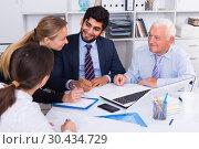 Купить «Managers are writing financial reports», фото № 30434729, снято 27 июня 2017 г. (c) Яков Филимонов / Фотобанк Лори