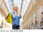 Купить «woman with shopping bags over mall background», фото № 30435005, снято 6 февраля 2014 г. (c) Syda Productions / Фотобанк Лори