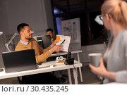 Купить «business team with papers working late at office», фото № 30435245, снято 26 ноября 2017 г. (c) Syda Productions / Фотобанк Лори