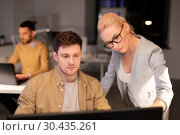 Купить «business team with computer working late at office», фото № 30435261, снято 26 ноября 2017 г. (c) Syda Productions / Фотобанк Лори