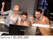 Купить «business team celebrating success at night office», фото № 30435269, снято 26 ноября 2017 г. (c) Syda Productions / Фотобанк Лори