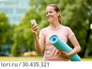 Купить «woman with exercise mat and smartphone at park», фото № 30435321, снято 15 июня 2018 г. (c) Syda Productions / Фотобанк Лори