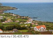 Купить «Small town in the Praia do Almoxarife area on the shores of the Atlantic Ocean, Faial Island, Azores», фото № 30435473, снято 4 мая 2012 г. (c) Юлия Бабкина / Фотобанк Лори