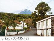 Купить «Pico Volcano over the street of the town of Sao Roque do Pico on Pico Island, Azores», фото № 30435485, снято 5 мая 2012 г. (c) Юлия Бабкина / Фотобанк Лори