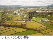 Купить «Aerial view of a village and fields on the island of Terceira, Azores», фото № 30435489, снято 5 мая 2012 г. (c) Юлия Бабкина / Фотобанк Лори