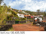 Купить «Village with traditional lava stone houses on Pico Island, Azores», фото № 30435505, снято 8 мая 2012 г. (c) Юлия Бабкина / Фотобанк Лори