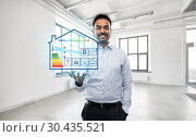Купить «realtor with smart home projection at empty office», фото № 30435521, снято 12 января 2019 г. (c) Syda Productions / Фотобанк Лори