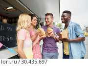 Купить «happy friends with drinks eating at food truck», фото № 30435697, снято 1 августа 2017 г. (c) Syda Productions / Фотобанк Лори
