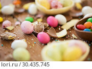 Купить «chocolate easter eggs and candy drops on table», фото № 30435745, снято 15 марта 2018 г. (c) Syda Productions / Фотобанк Лори
