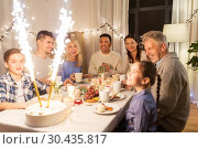 Купить «happy family having dinner party at home», фото № 30435817, снято 15 декабря 2018 г. (c) Syda Productions / Фотобанк Лори