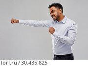 Купить «angry indian businessman fighting over grey», фото № 30435825, снято 12 января 2019 г. (c) Syda Productions / Фотобанк Лори