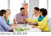 Купить «team of fashion designers working at office», фото № 30435941, снято 17 мая 2014 г. (c) Syda Productions / Фотобанк Лори