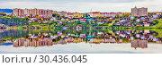 Купить «The beautiful houses of the city of Beloretsk are reflected in the reservoir of the Belaya River.», фото № 30436045, снято 26 мая 2019 г. (c) Акиньшин Владимир / Фотобанк Лори