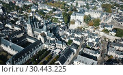 Купить «View from drone of French city of Blois with Royal Chateau and church of St. Nicolas in sunny autumn day», видеоролик № 30443225, снято 25 октября 2018 г. (c) Яков Филимонов / Фотобанк Лори