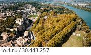 Купить «Aerial view of ruined medieval castle of Chateau de Beaucaire on background of French commune of Beaucaire», видеоролик № 30443257, снято 24 октября 2018 г. (c) Яков Филимонов / Фотобанк Лори