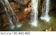 Купить «Waterfall in Catalonia surrounded by beautiful forests and valleys», видеоролик № 30443465, снято 23 марта 2018 г. (c) Яков Филимонов / Фотобанк Лори