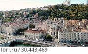 Купить «View from drone of Cathedral of Saint-Jean and Notre Dame Basilica on Fourviere hill on bank of river Saone in Lyon, France», видеоролик № 30443469, снято 12 октября 2018 г. (c) Яков Филимонов / Фотобанк Лори