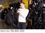 Купить «Sporty woman is choosing new equipment for diving», фото № 30447293, снято 25 января 2018 г. (c) Яков Филимонов / Фотобанк Лори