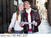 Купить «Smiling couple man and woman with map», фото № 30447337, снято 18 ноября 2017 г. (c) Яков Филимонов / Фотобанк Лори