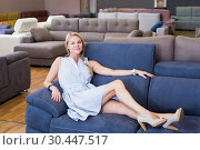 Купить «Beautiful woman is testing new sofa», фото № 30447517, снято 19 июня 2017 г. (c) Яков Филимонов / Фотобанк Лори