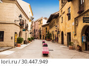Купить «The Spanish village in Barcelona is an open-air Museum. Catalonia, Spain», фото № 30447949, снято 6 апреля 2018 г. (c) Наталья Волкова / Фотобанк Лори