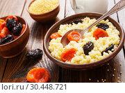 Купить «Millet porridge with dried fruits», фото № 30448721, снято 26 марта 2019 г. (c) Надежда Мишкова / Фотобанк Лори
