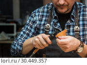 Купить «Concept of handmade craft production of leather goods.», фото № 30449357, снято 13 марта 2019 г. (c) Jan Jack Russo Media / Фотобанк Лори