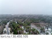 Купить «Green field with winter crops. Fields covered with snow.», фото № 30450105, снято 2 января 2019 г. (c) Андрей Радченко / Фотобанк Лори