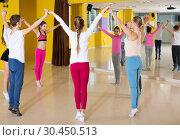 Купить «Children with teacher dancing in circle», фото № 30450513, снято 3 марта 2018 г. (c) Яков Филимонов / Фотобанк Лори