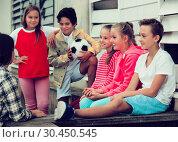 Купить «Kids talking on city walk», фото № 30450545, снято 7 сентября 2017 г. (c) Яков Филимонов / Фотобанк Лори