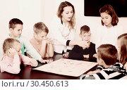 Купить «Elementary age thoughtful children at table with board game and dice», фото № 30450613, снято 5 ноября 2016 г. (c) Яков Филимонов / Фотобанк Лори