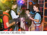 Купить «Kids posing with laser pistols», фото № 30450793, снято 24 октября 2018 г. (c) Яков Филимонов / Фотобанк Лори