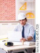 Купить «Construction supervisor working on blueprints», фото № 30451729, снято 13 сентября 2018 г. (c) Elnur / Фотобанк Лори