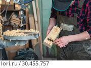 Купить «Carpenters with electric drill machine drilling wooden board», фото № 30455757, снято 5 февраля 2019 г. (c) Jan Jack Russo Media / Фотобанк Лори
