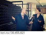 Купить «Adult winery workers holding bottle of wine», фото № 30455821, снято 27 мая 2019 г. (c) Яков Филимонов / Фотобанк Лори