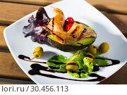 Купить «Delicious fried legs of quail with balsamic pasta, avocado and greens», фото № 30456113, снято 15 июня 2019 г. (c) Яков Филимонов / Фотобанк Лори