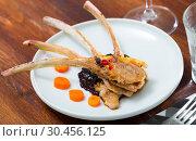 Купить «Roasted rack of mutton with berry sauce and carrot», фото № 30456125, снято 22 мая 2019 г. (c) Яков Филимонов / Фотобанк Лори