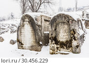 Tombstones at the old Jewish Cemetery which lies on the slopes of Trebevic mountain in Sarajevo capital of Bosnia Herzegovina (2018 год). Редакционное фото, фотограф Николай Коржов / Фотобанк Лори