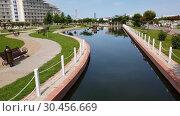 Купить «Sochi, Russia - May 31. 2018 Pond in three-star hotel Sochi Park», видеоролик № 30456669, снято 28 февраля 2019 г. (c) Володина Ольга / Фотобанк Лори