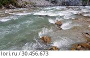 Купить «Fragment of a mountain river in Abkhazia», видеоролик № 30456673, снято 28 февраля 2019 г. (c) Володина Ольга / Фотобанк Лори