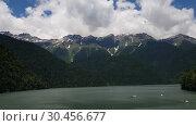 Купить «Beautiful Mountains surrounding Ritsa Lake in an Abkhazia», видеоролик № 30456677, снято 28 февраля 2019 г. (c) Володина Ольга / Фотобанк Лори