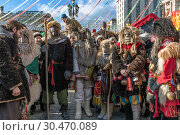 Купить «Moscow, Russia - March 9. 2019. Masked men during celebration of Shrovetide on Manezh Square», фото № 30470089, снято 9 марта 2019 г. (c) Володина Ольга / Фотобанк Лори