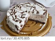 Купить «Cut into pieces Low-fat yoghurt cake with a chocolate», фото № 30470805, снято 8 марта 2019 г. (c) Володина Ольга / Фотобанк Лори