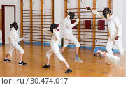 Купить «Mixed group of fencers trains in pairs», фото № 30474017, снято 30 мая 2018 г. (c) Яков Филимонов / Фотобанк Лори