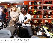 Купить «Happy young couple choosing and buying new motorcycle in moto salon», фото № 30474197, снято 16 января 2019 г. (c) Яков Филимонов / Фотобанк Лори