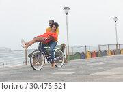 Купить «Couple enjoying at bicycle while riding at pavement », фото № 30475521, снято 14 ноября 2018 г. (c) Wavebreak Media / Фотобанк Лори