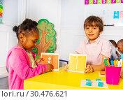 Купить «Boy with girl in nursery button and zip clothes», фото № 30476621, снято 3 февраля 2019 г. (c) Сергей Новиков / Фотобанк Лори