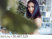 Купить «Attractive brunette woman in the kitchen.», фото № 30487529, снято 18 марта 2019 г. (c) Женя Канашкин / Фотобанк Лори
